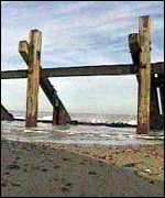 [ image: Flood defences have already been torn down by the sea]