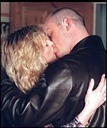 [ image: Earning his keep: In a clinch with sister-in-law Kathy (Gillian Taylforth)]
