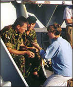 [ image: On ship with two Royal Marines]