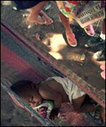 An 11-month old girls sleeps outside in a hammock