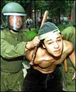 [ image: A Pinochet protester is arrested at the Spanish embassy in Chile]