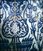 [ image: Walls are decorated with patterned tiles]