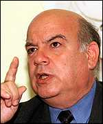 [ image: Chile's foreign minister Jose Miguel Insulza promises a trial at home]