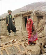 [ image: Afghan villagers survey the damage after a strong earthquake]