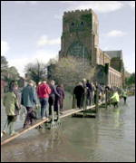 [ image: Spring floods forced Shrewsbury residents to walk the plank]