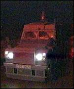 [ image: Riot police in landrovers moved in]