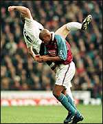 [ image: Jaap Stam goes flying after a challenge with Dion Dublin]