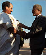 [ image: Mr Annan shakes hands with Polisario leader]