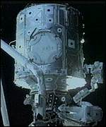 [ image: Astronauts had to remove four hatches from the module]