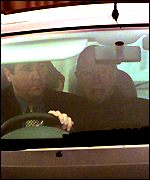 [ image: Wanted: General Pinochet (right) driven from court]