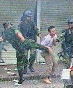 [ image: Soldiers lash out at protesters]