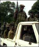 [ image: Soldiers touring Freetown]