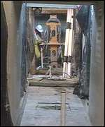[ image: Workers have been digging shafts beneath the structure since 1993]
