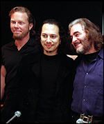 [ image: Metallica's James Hetfield and Kirk Hammett with Michael Kamen]