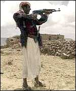 [ image: Yemeni tribesmen sport Kalashnikovs as well as the traditional dagger]