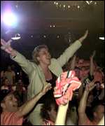 [ image: Sylvie Barneveld celebrates with Dutch fans]