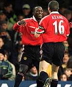 [ image: Hat-trick hero Dwight Yorke celebrates with Roy Keane]