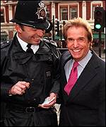 [ image: The Fonz makes friends with a British bobby]