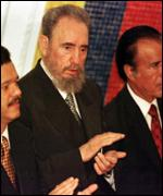 [ image: Cuba's Fidel Castro joined other foreign guests for the ceremony]