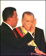 [ image: Outgoing President Rafael Caldera looks on at the swearing in]