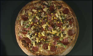 Pizza chain shrugs off economy woes