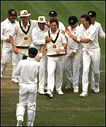 [ image: Waugh is congratulated by team-mates for his 1989 heorics]