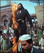 [ image: Muslims in Bombay burn an effigy of Salman Rushdie]