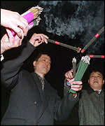 [ image: Lighting joss sticks at Longhua Temple in Shanghai]