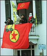 [ image: The PKK flag flies in The Hague where three hostages are being held]