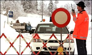 [ image: A Swiss policeman stands by a road block in Saas, Swiss Alps]