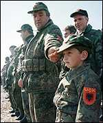 [ image: Iliar Qerimi, 8, wearing a KLA uniform]