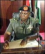 [ image: General Abubakar signs in as president - he has pledged to sign out, too]