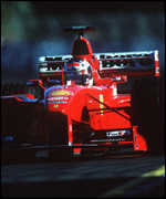 [ image: Back of grid: Michael Schumacher]