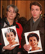 [ image: Sister and son of Laurence Penon, a stewardess killed in the bombing, at the opening of the trial]