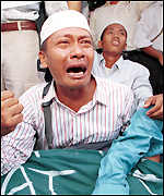 [ image: Muslim Solidarity members protest religious killings]
