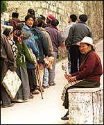 [ image: Thousands of Tibetans sneak to India to catch a glimpse of the exiled leader]