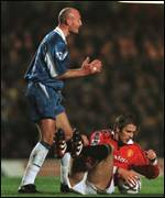 [ image: Beckham goes down after a challenge from Leboeuf]