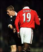 [ image: Yorke exchanges words with referee Durkin, who sent off two on Sunday]