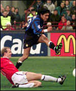 [ image: Berg slides in to tackle the livewire Zamorano]