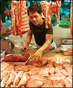 [ image: Singapore pork stall quiet after death of slaughterhouse worker]