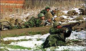 [ image: Yugoslav army troops advance on rebel positions]