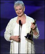 [ image: Dame Judi collects her Academy Award]