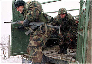 [ image: Serbian troops moved in to Kosovo after the international monitors left]