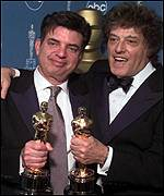 [ image: Marc Norman and Tom Stoppard picked up the Oscar for best original screenplay]