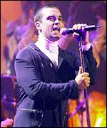 [ image: Robbie Williams at the 1999 Brit Awards]