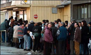 [ image: Residents in Belgrade venture outside to queue for bread on Thursday morning]