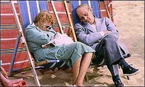 old couple sleep in deckchairs