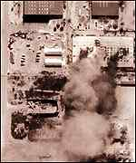 [ image: Aerial photograph of the bombing, handed to reporters]