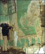 [ image: Press were invited to survey damage after the bombing of Iraq]