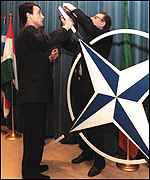 [ image: Preparing the stage for a Nato press conference]